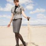businesswoman-pouring-sand-out-of-shoe_HKGEULArj-500
